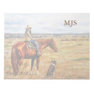 Pequeña vaquera en caballo del ganado bloc de notas