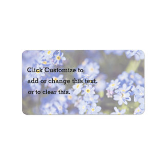 Pequeñas flores azules etiquetas de dirección
