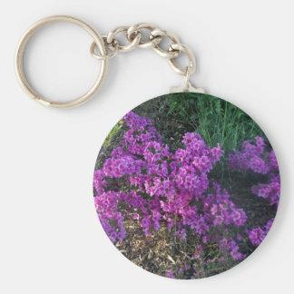 Pequeñas flores de color rosa oscuro llaveros personalizados