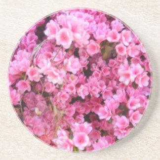 Pequeñas flores posavasos diseño