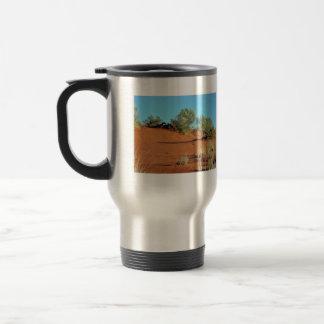 Pequeñas plantas en dunas de arena rojas tazas de café