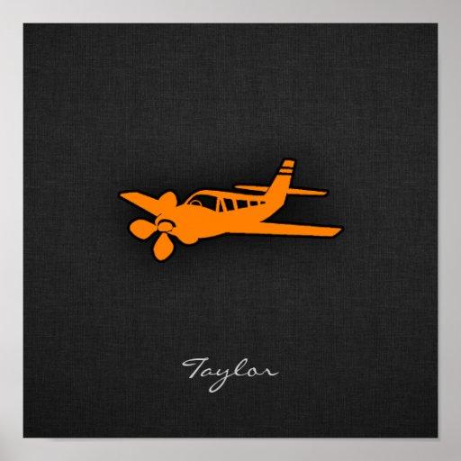 Pequeño aeroplano anaranjado impresiones