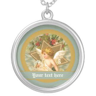 Pequeño ángel lindo y estrella del navidad del collar plateado