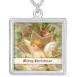 Pequeño ángel lindo y estrella del navidad del vin pendiente