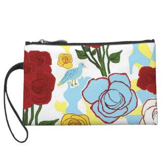 Pequeño bolso de embrague con los rosas