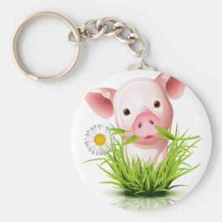 Pequeño cerdo rosado en hierba llaveros personalizados