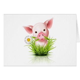 Pequeño cerdo rosado en hierba tarjeta