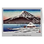 Pequeño edificio nevado en la costa tarjeta