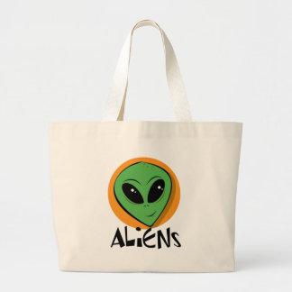 Pequeño extranjero verde bolsa