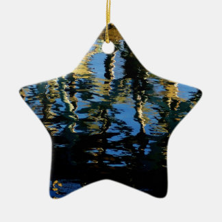 pequeño grebe perdido adorno navideño de cerámica en forma de estrella
