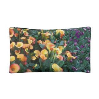 Pequeño jardín de flores cosmético del bolso en