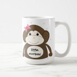 Pequeño mono con una diadema para el pelo rosada taza