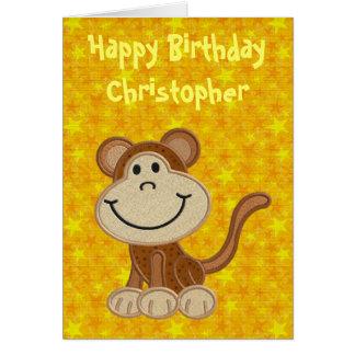 Pequeño mono del feliz cumpleaños felicitación
