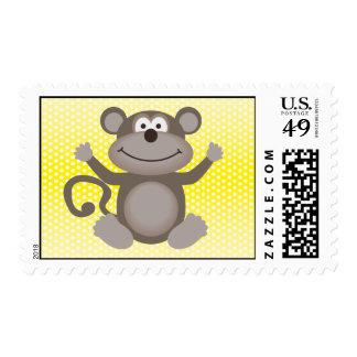 Pequeño mono lindo en amarillo sellos