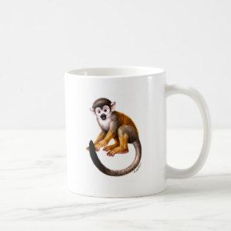 Pequeño mono taza de café