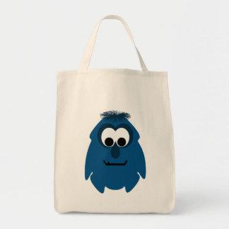 Pequeño monstruo azul marino tonto bolsas