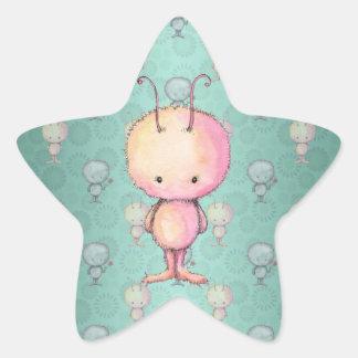 Pequeño monstruo lindo pegatina en forma de estrella