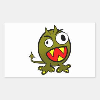 Pequeño monstruo verde enojado divertido pegatina rectangular