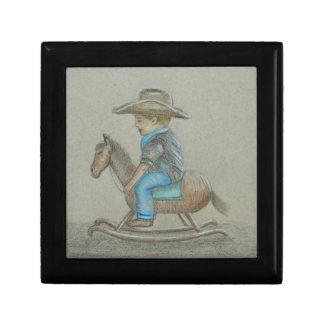 pequeño montar a caballo del vaquero en caballo caja de recuerdo