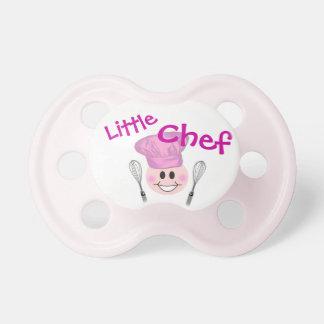Pequeño pacificador del cocinero chupete de bebé