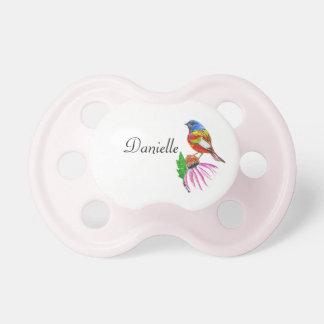 Pequeño pájaro pacificador rosado de muchos color chupete de bebé