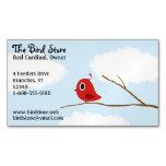 Pequeño pájaro rojo en una rama de árbol