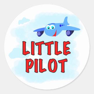 Pequeño piloto del aeroplano azul pegatina redonda