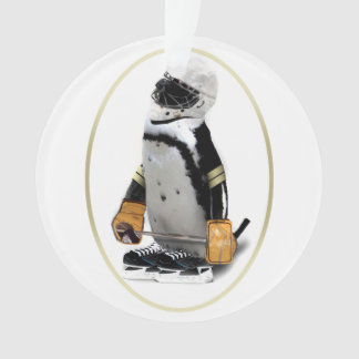 Pequeño pingüino del jugador de hockey de la masco