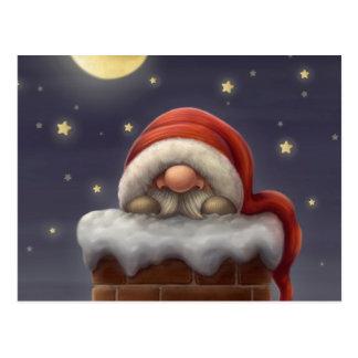 Pequeño Santa en una chimenea Postal