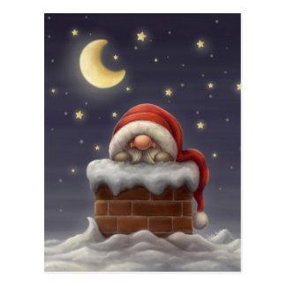Pequeño Santa en una chimenea Postales