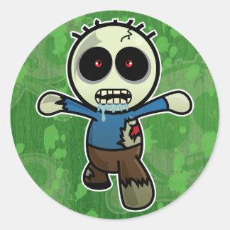 Pequeño zombi lindo del dibujo animado pegatina redonda