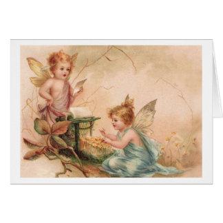 Pequeños ángeles en rosa y azul tarjeta de felicitación