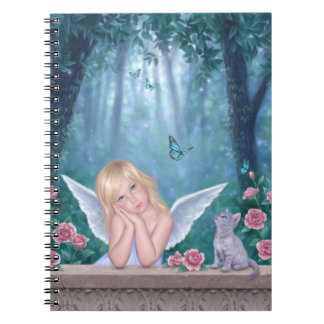 Pequeños niño del ángel de los milagros y cuaderno