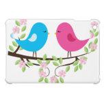 Pequeños pájaros en rama floral