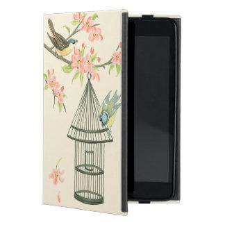 Pequeños pájaros encaramados en una rama y en un iPad mini cobertura
