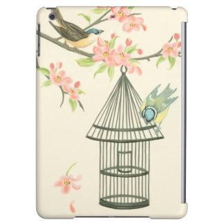 Pequeños pájaros encaramados en una rama y en un