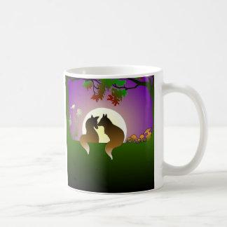 Pequeños zorros taza de café