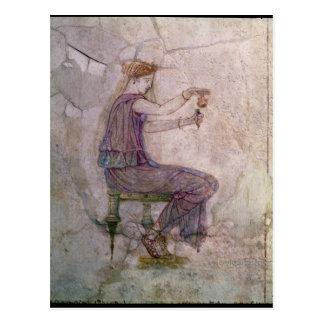 Perfume de colada de la mujer en una redoma postales