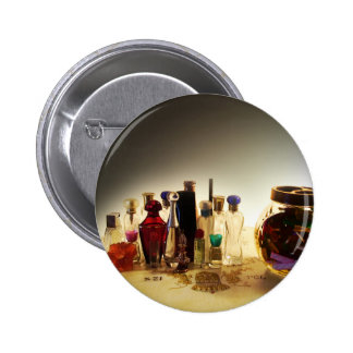 Perfumes and candies on a table pinback button