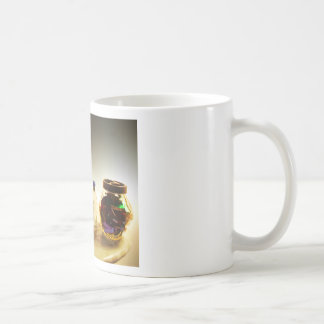 Perfumes and candies on a table coffee mug