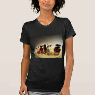 Perfumes and candies on a table t shirts