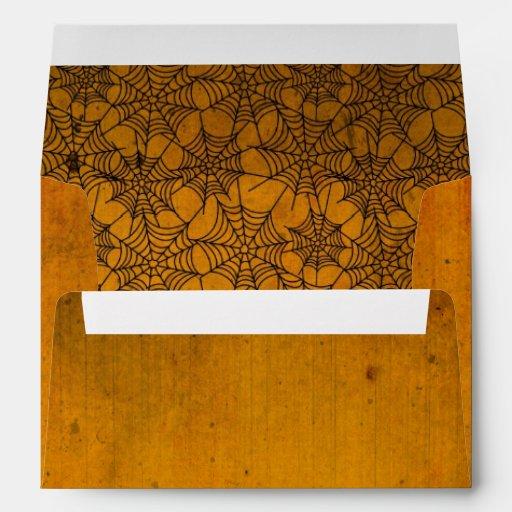 Pergamino anaranjado de Halloween con el Web de ar Sobres