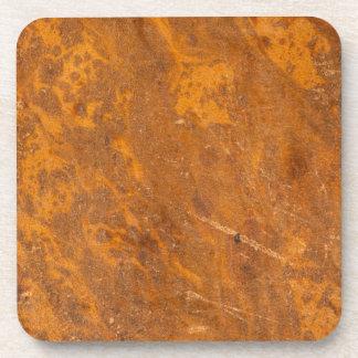 Pergamino de cuero antiguo de la cubierta de libro posavasos