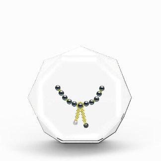 Perlas de oro del negro de la borla