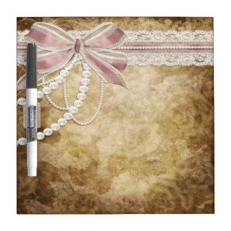 Perlas florales del vintage y tablero seco del bor pizarras blancas