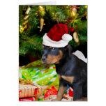 Perrito de Rottweiler del navidad Tarjetón