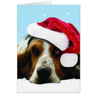Perrito de silencio con el gorra de santa tarjeta de felicitación