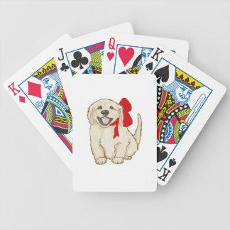 Perrito del golden retriever con la cinta roja cartas de juego