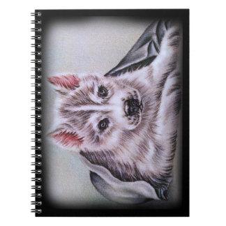 Perrito del husky siberiano con el dibujo notebook