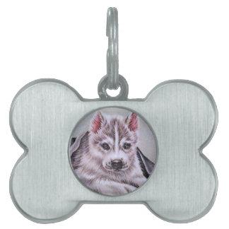 Perrito del husky siberiano con el dibujo placa mascota